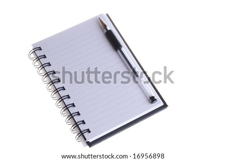 A blank notebook with a pen on top - stock photo