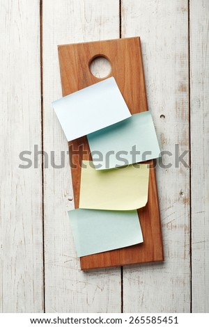 A Blank Recipe Cards (or Shopping List) on a kitchen board - stock photo