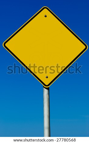 A blank road sign isolated on a blue graduated sky. - stock photo