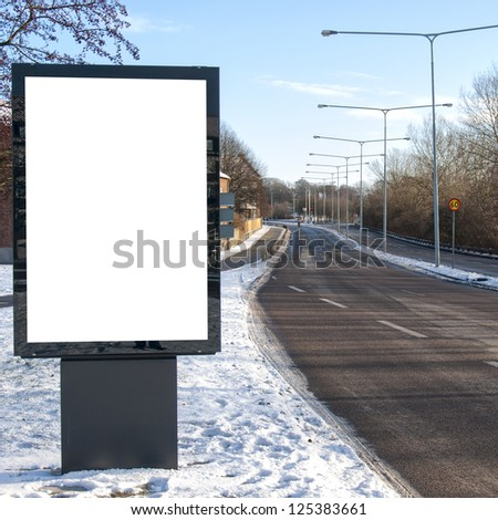 A blank roadside billboard for your advertising purposes. - stock photo