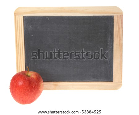 A blank school chalkboard with a red apple. - stock photo