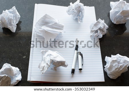 A blank sheet of paper. Paper Ball, Wad, Lump. Black Background. Pencil. Writers Block. Letter. - stock photo