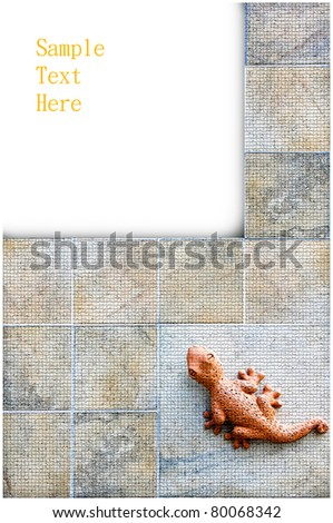 A blank sign with a gecko on wall - stock photo