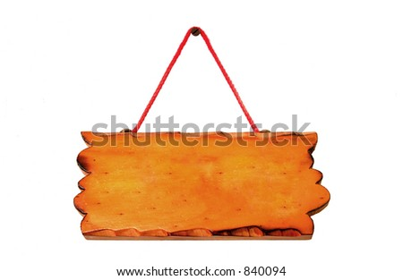 A blank signboard hanging from a nail. - stock photo