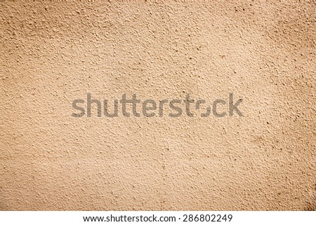 A blank, slightly grungy stucco wall, perfect for background and messages.