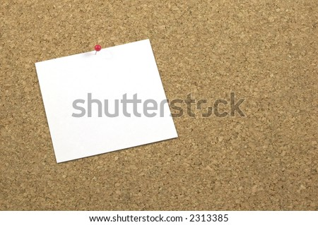 A blank square piece of white paper pinned on a cork noticeboard, space for copy