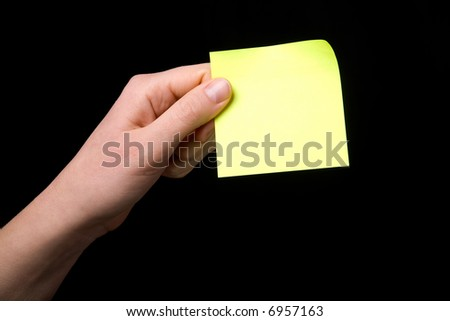 A blank sticky note stuck to a hand - remember this - stock photo