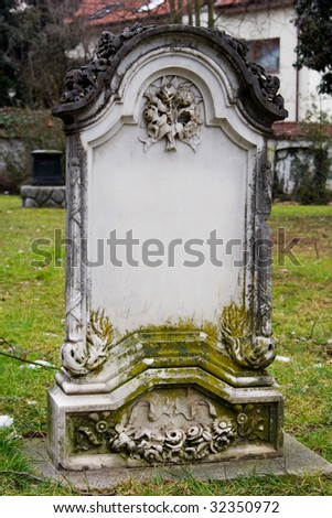 a blank tombstone covered with a moss - stock photo