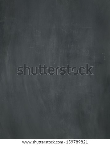 A blank used chalkboard texture. - stock photo