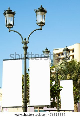 A blank white sign on the city street . - stock photo