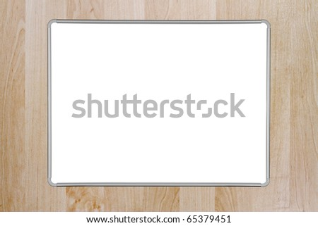 A blank whiteboard mounted on a wooden wall. Inner and outer clipping paths included for the whiteboard - stock photo