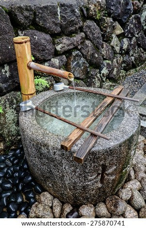 A blessed  jar in the temple. You have to wash your hand and mind before you go in the temple - stock photo