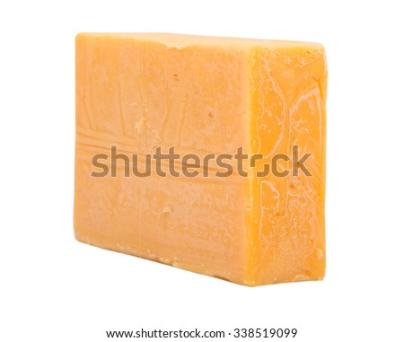 A block of cheddar cheese over white background - stock photo