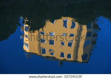 A block of flats reflected on the surface of water, Sweden.