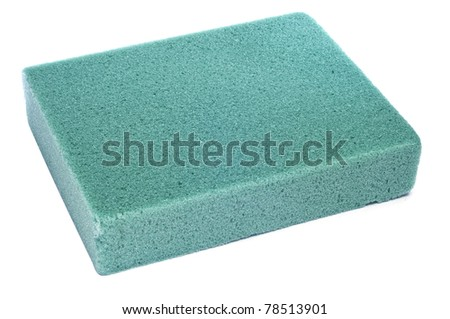 a block of floral foam on a white background