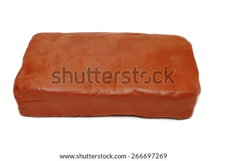 a block of modelling clay on a white background - stock photo