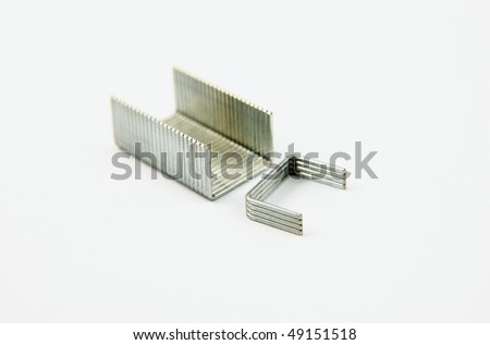 A block of staples on a white background - stock photo