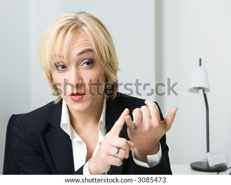A blond business girl counting or giving arguments