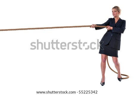 A blond businesswoman pulling on a long piece of rope, isolated on a white background.