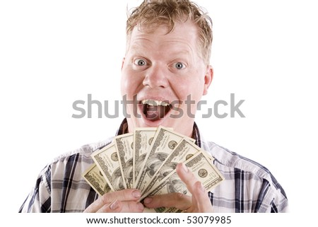 A blond man with an excited face and a handful of fanned money.