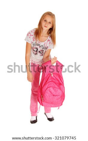 A blond pretty girl lifting her heavy pink backpack for school, standingisolated for white background. - stock photo