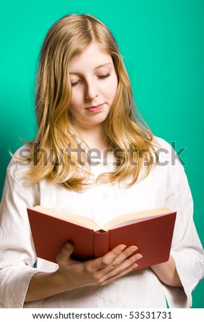 a blond teenager girl in white shirt reading a book - stock photo