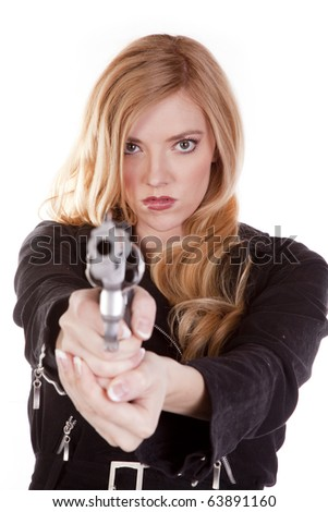 A blond woman is looking down a gun. - stock photo
