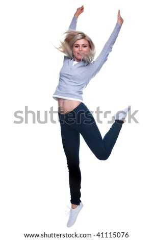 A blond woman jumping in the air, slight motion blur. Isolated on a white background.