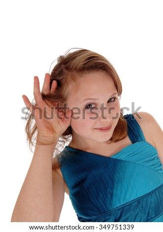 A blond young girl in a black dress with one hand behind her ear can nothear well, isolated for white background. - stock photo