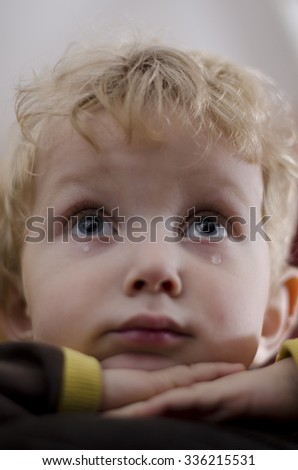 A blonde boy crying - stock photo