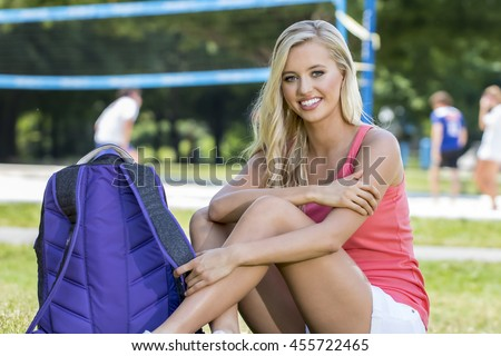 A blonde model posing in an outdoor environment - stock photo