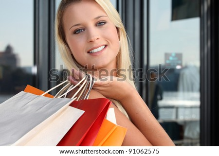a blonde woman doing shopping - stock photo