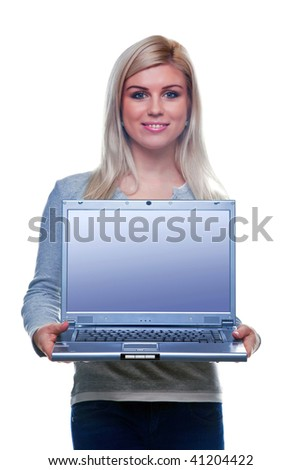 A blonde woman in casual clothing holding a laptop computer towards camera, screen has a clipping path to add your own image or text.