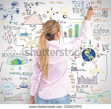 A blonde women drawing her project - stock photo