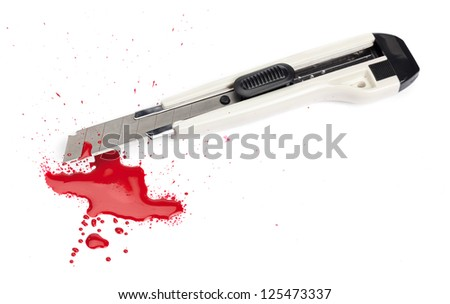 A blood covered boxcutter and spatter of blood isolated on a white background.