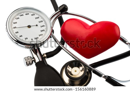 a blood pressure meter, a heart and stethoscope lying on a white background - stock photo