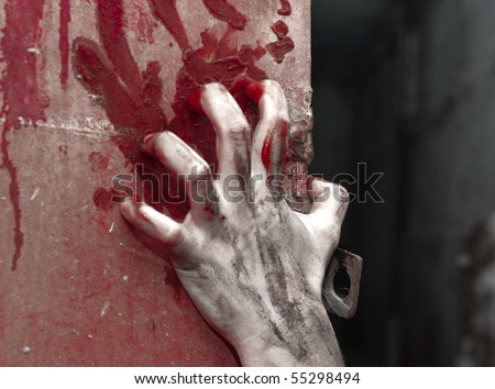a bloody hand over background with claret - stock photo