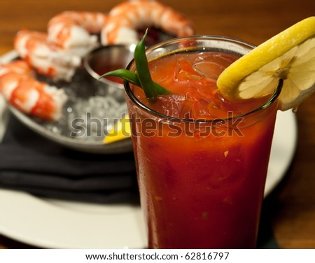 A Bloody Marry with a shrimp cocktail, shot at a French restaurant. - stock photo