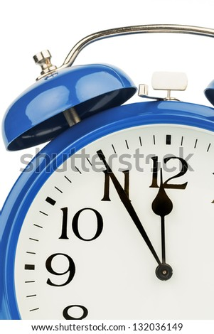 a blue alarm clock on a white background. five to twelve - stock photo