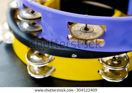 a blue and yellow traditional tambourines closeup - stock photo