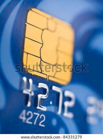 a blue bank card, macro, narrow focus - stock photo