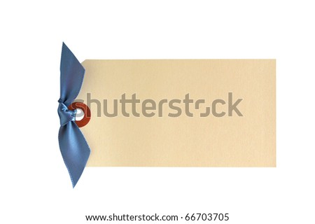 A blue bow is tied in the hole of a hanging tag isolated on white with a clipping path. - stock photo