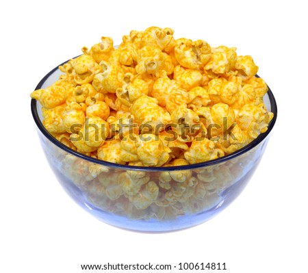 A blue bowl filled with cheese flavored popcorn on a white background. - stock photo