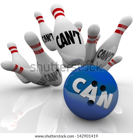A blue bowling ball with the word Can hits a strike against pins with the word Can't to illustrate dedication, determination and a positive attitude to win the game - stock photo