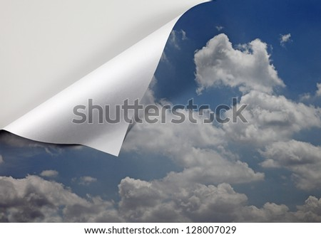 A blue cloudy sky unfolding at the edge with blank space for text. - stock photo