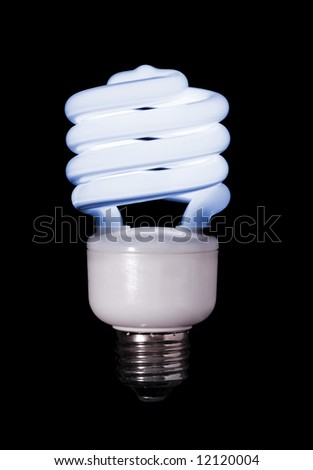 A blue compact fluorescent light bulb, black background. - stock photo