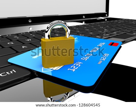 A blue credit card and a lock on a laptop: Online security concept - stock photo