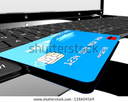 A blue credit card on a laptop: Online payments concept - stock photo