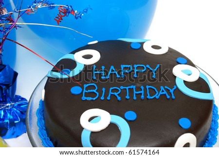 A blue decorated cake with happy birthday writing. - stock photo
