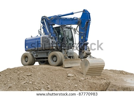 a blue digger resting on a earth pile, outdoor shot in white back